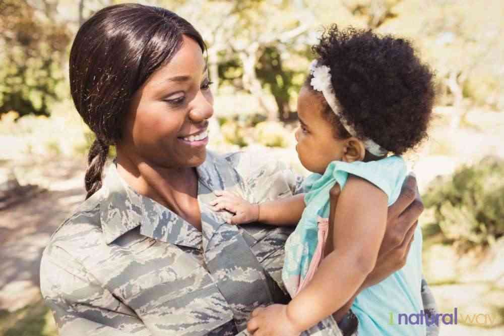 military-mom-with-child- breastfeeding while traveling