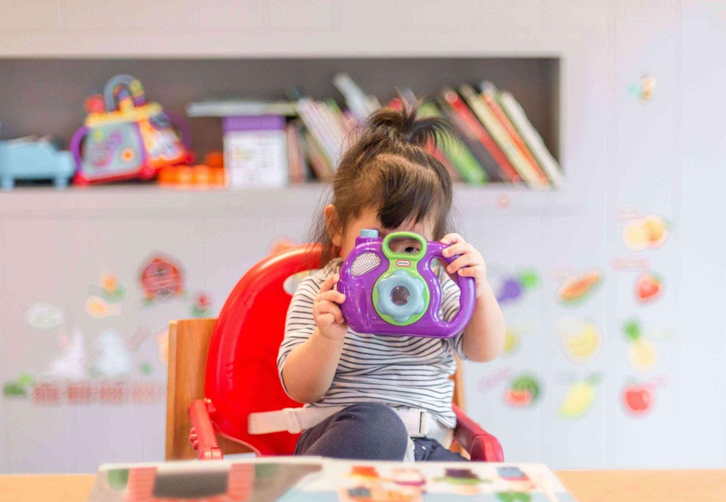 girl-with-toy-book-in-baby's-room