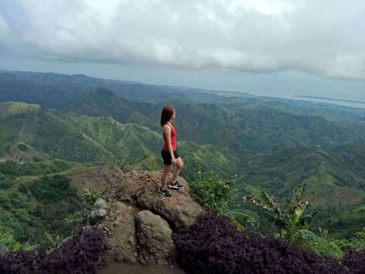 mom-reaching-her-fitness-goals-quicker-on-top-of-mountain