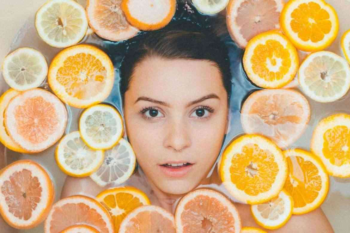 woman-skin-tightening-with-lemons-and-oranges