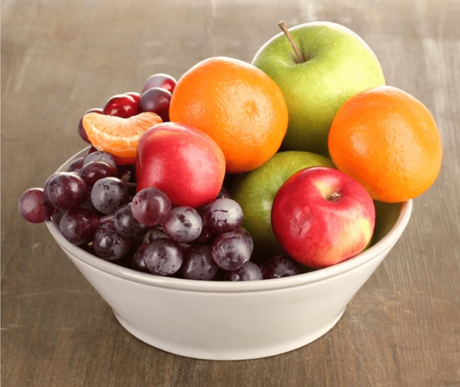 bowl of fruit on a wooden table