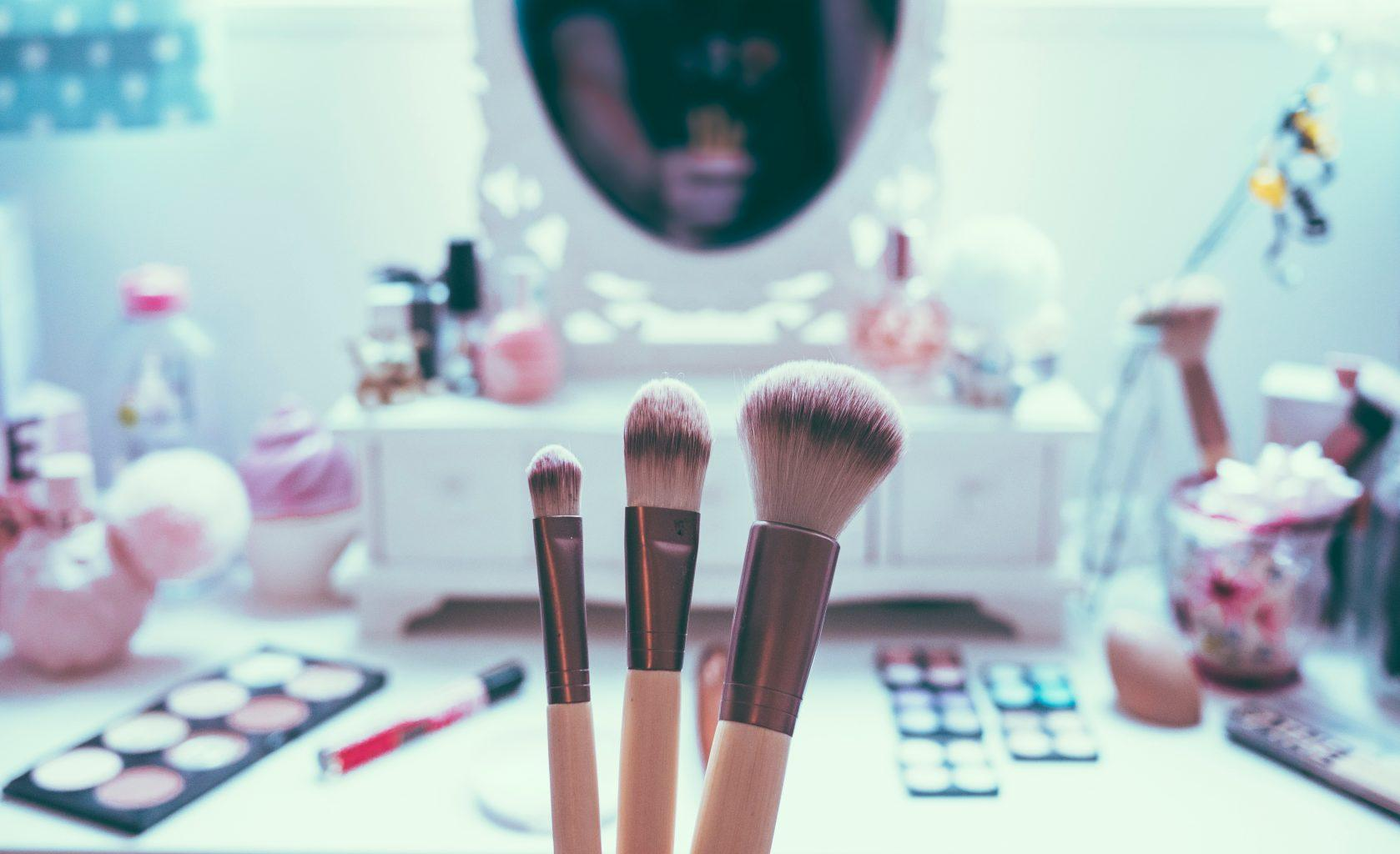 """""""mirror on a desk with make-up brushes"""""""