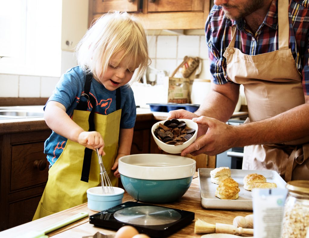 non-toy gift idea child baking with parent