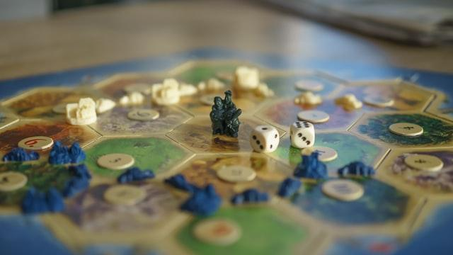 old school games are the best way to celebrate Father's Day; dices spread on a board game