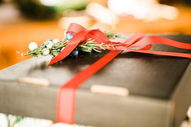 Father's Day, gift box with red ribbon placed on a table