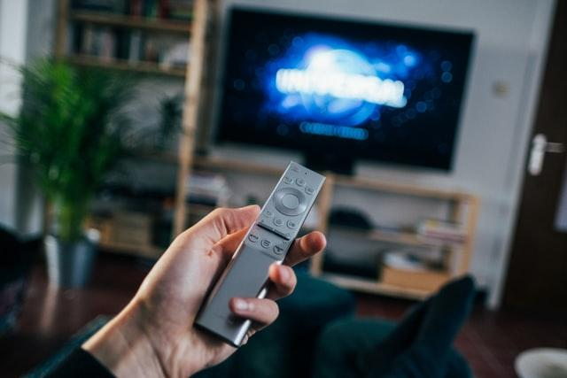 Father's Day, hand holding a remote with a TV in the background